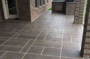 A patio deck that looks like tiles but is actually concrete resurfacing